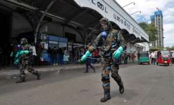 Sri Lankan government soldiers in protective clothes spray