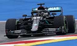 Lewis Hamilton takes pole position at F1's rain-soaked