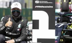 Mercedes driver Valtteri Bottas of Finland, wearing a mask