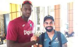 Jason Holder with Virat Kohli