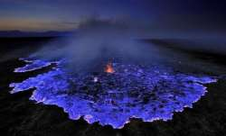 Volcano in Indonesia erupts with electric blue lava