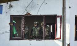 Army personnel conduct searches in the house where militants were hiding, after an encounter with th