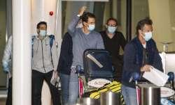 Spain's Rafael Nadal, center, arrives at Adelaide Airport