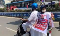 Mamata Banerjee rides pillion on electric scooter to