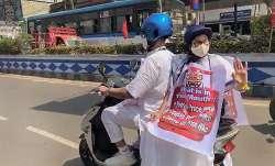 West Bengal Chief Minister Mamata Banerjee rides pillion on