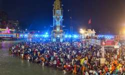Devotees offer prayers during Ganga aarti at Kumbh Mela 2021, in Haridwar