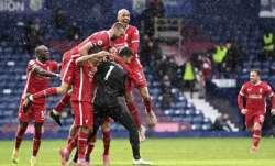 Liverpool's goalkeeper Alisson celebrates with teammates