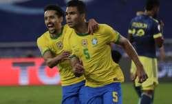 Brazil's Casemiro, right, celebrates with teammate