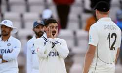 Virat Kohli of India talks to Kyle Jamieson after the