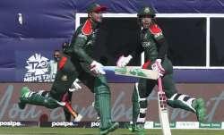 Bangladesh's Shakib Al Hasan and teammate Mushfiqur Rahim cross as they run between the wickets duri