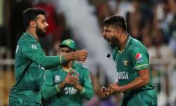 Pakistan's Haris Rauf celebrates the dismissal of New Zealand's Martin Guptill during the Cricket Tw