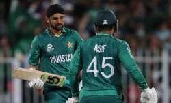 Pakistan's Shoaib Malik, left, celebrates with Asif Ali