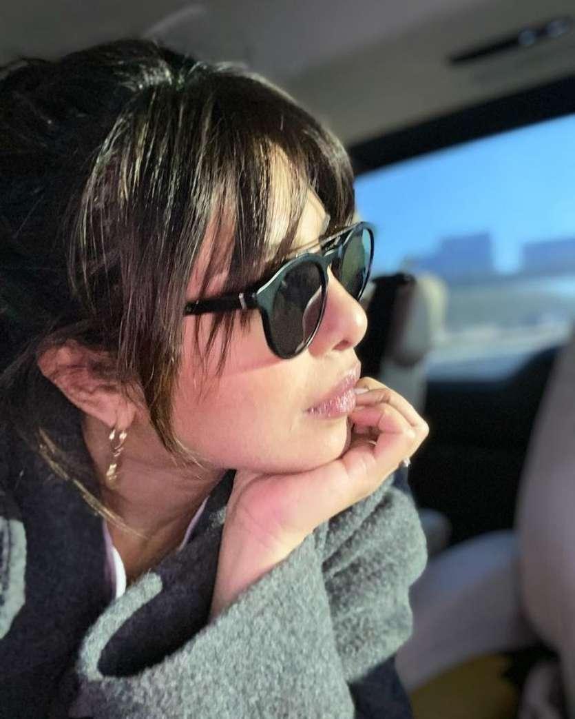 A casual picture of Priyanka Chopra Jonas wearing big black shades.