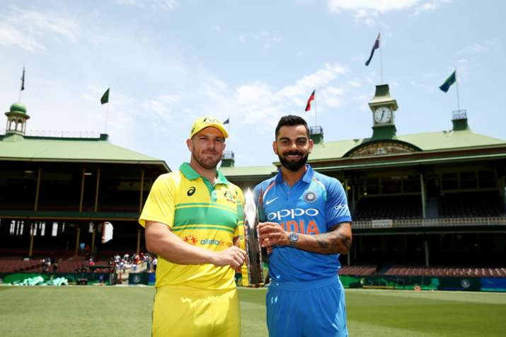 The two captains pose with the ODI series trophy.
