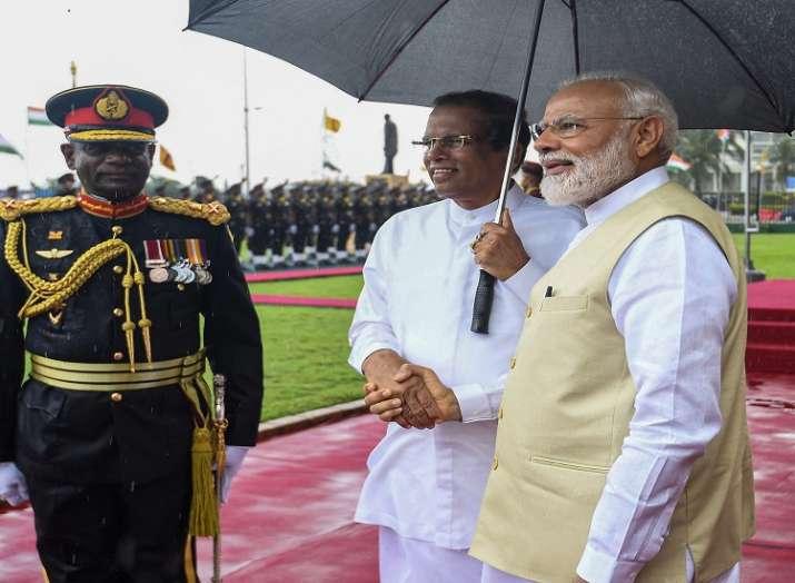 Prime Minister Narendra Modi shakes hands with Sri Lankan